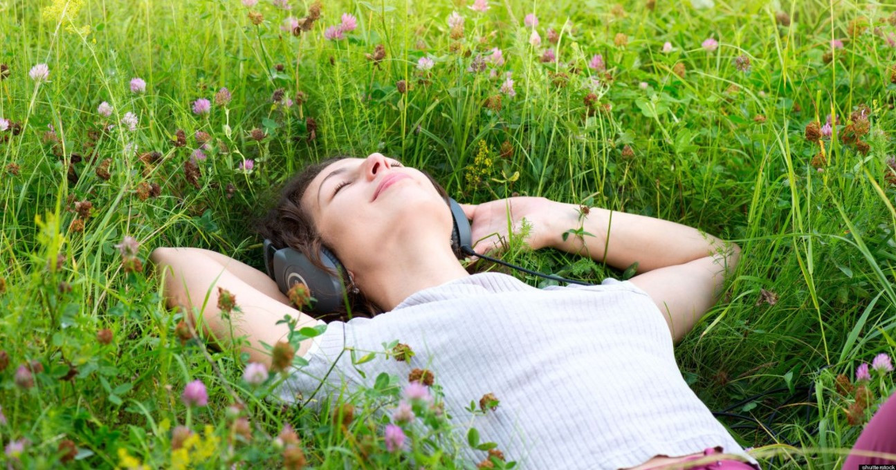 girl resting in the grass