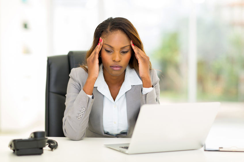 black woman tired behind the pc