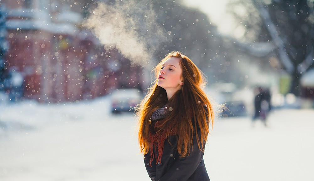 girl breathing at winter
