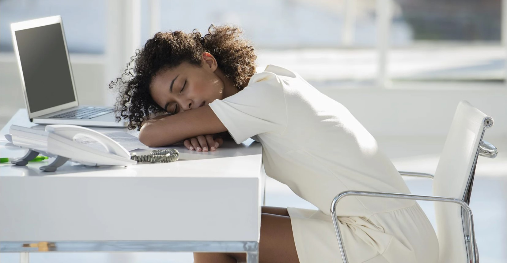 black woman sleep at work