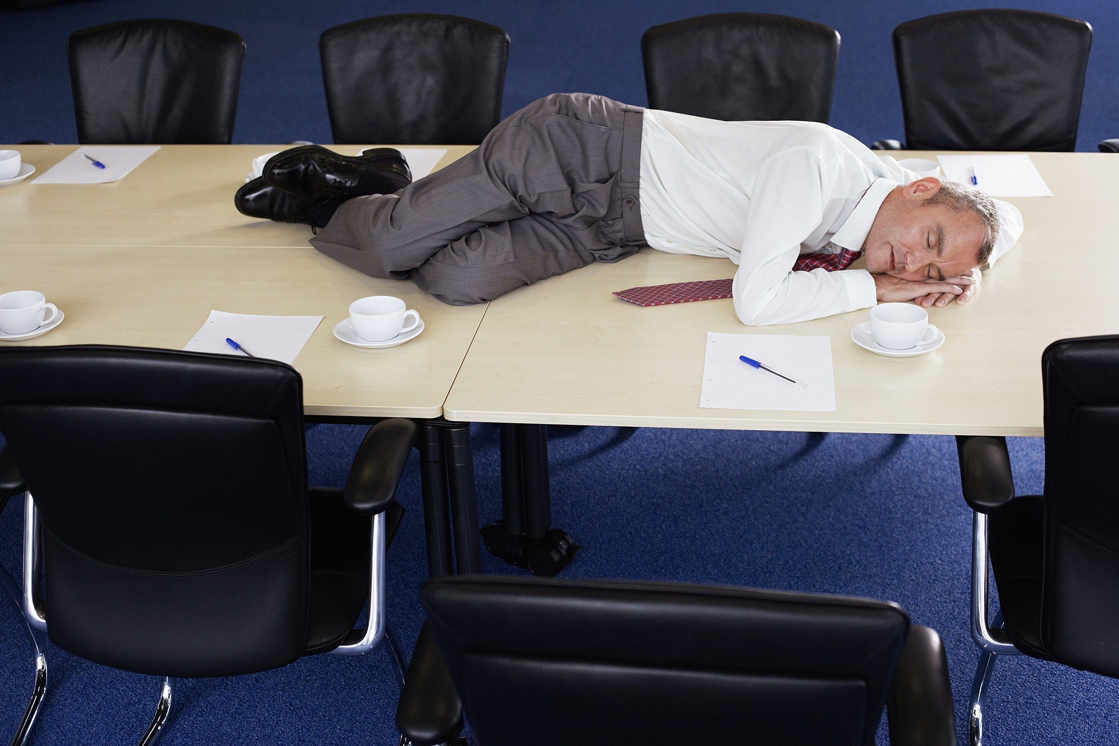 old man sleep at table during work